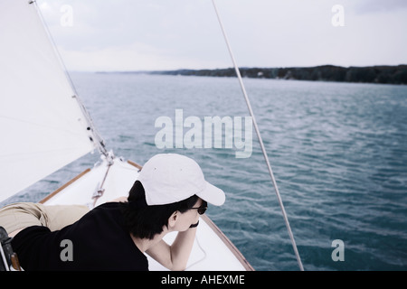 Young Woman Resting On Deck Of Sailboat - Stock Photo