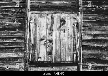 Closed Wooden Shutter Of Farm House On Alpine Pasture Dolomites European Alps Italy - Stock Photo