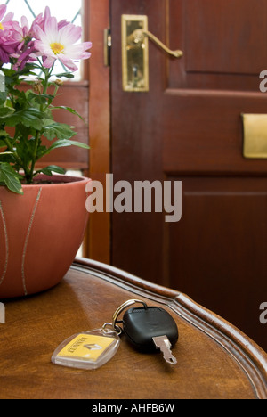 Car key left on a table by the front door. - Stock Photo