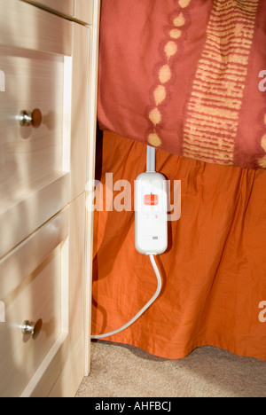 Electric blanket switch on a bed - Stock Photo