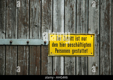 Yellow sign on wooden door, no entry - Stock Photo