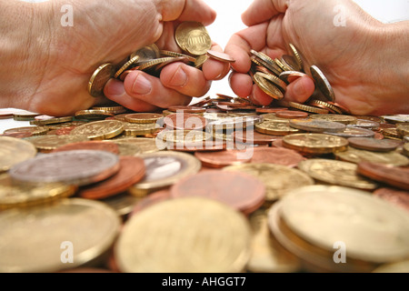 grabbing all the money hands grabbing coins isolated white background - Stock Photo