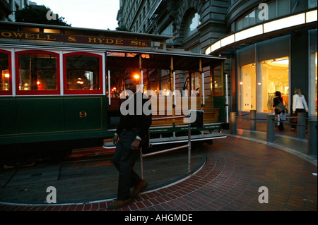 powell and market cable car being turned by the driver at turnaround end of powell san francisco california usa - Stock Photo