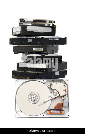 Pile of hard discs against a white background - Stock Photo