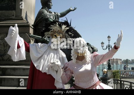 Two human statues in Venice, Italy with the real thing behind. - Stock Photo