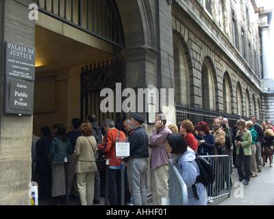 Tourists stand in line to enter the Palais de Justice Paris France - Stock Photo