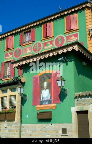 Paul Bocuse restaurant house, Paul Bocuse fresco on green wall, Collonges, Au Mont d'Or, near Lyon, Rhône, France, - Stock Photo