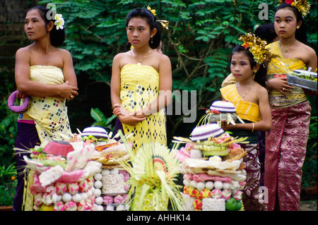 Balinese generations at temple festival - Stock Photo