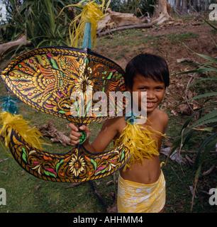 MALAYSIA Southeast Asia Kelantan Kota Bharu Malay boy holding traditional multicoloured kite. - Stock Photo
