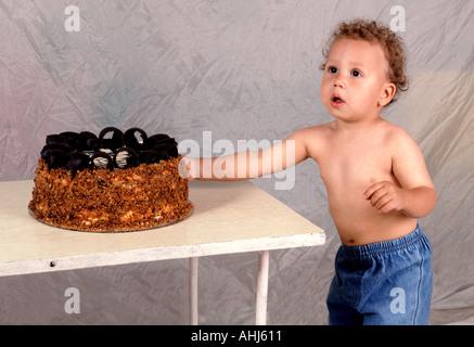 children birthday fruit cake banana kiwi strawberry and orange child childcare Caucasian party costumes dessert - Stock Photo