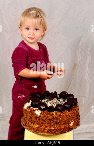 children birthday fruit cake banana kiwi strawberry and orange child childcare cut out cropped white background - Stock Photo