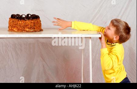children birthday fruit cake banana kiwi strawberry cut out cropped white background outline cutout - Stock Photo