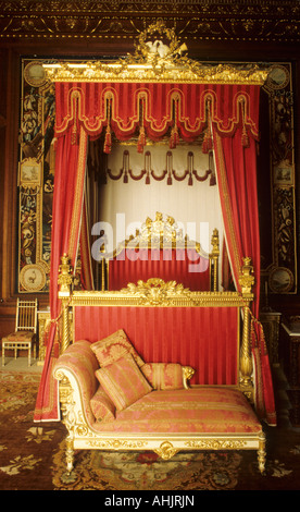 Burghley House, near Stamford, interior, bedroom, gilded 4 poster bed bedroom, drapes curtains English stately home - Stock Photo