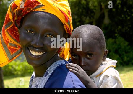 Mother Baby Smile Woman Maasai Africa African tribe Kenya Tanzania - Stock Photo