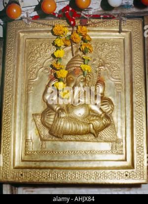 Amritsar India Langa Wali Devi Ganesh Flower Garlands Marigolds on Brass Plaque - Stock Photo