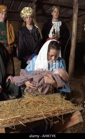 Mary and baby Jesus in live nativity scene - Stock Photo