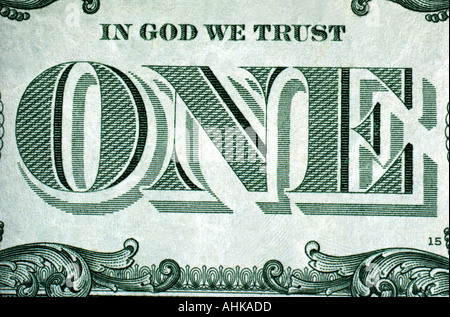 Close up of In God We Trust and ONE on reverse side of United States one dollar bill - Stock Photo