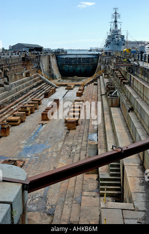 Dry Dock 1 with USS Cassin Young in background at Charlestown Navy Yard Boston Massachusetts USA - Stock Photo