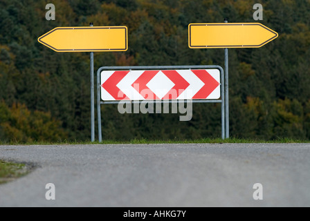 traffic sign arrows pointing left and right Germany - Stock Photo