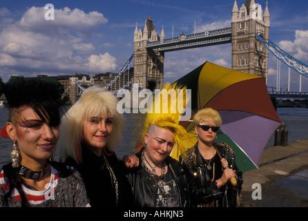 Four female Punks pose in front of Tower Bridge London England UK - Stock Photo