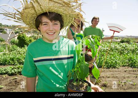 Family in vegetable garden - Stock Photo