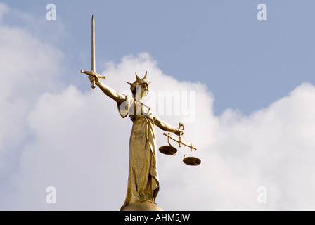 Lady Justice statue atop the Old Bailey central criminal court in the City of London UK - Stock Photo