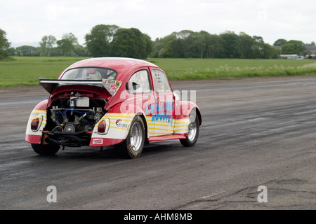 heavily modified VW beetle competing in drag race - Stock Photo