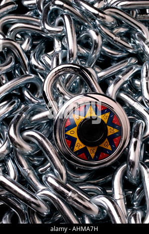 A pile of steel chain with combination lock - Stock Photo