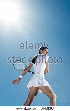 Tennis player playing tennis - Stock Photo