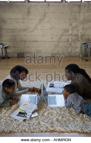 Family doing children's homework - Stock Photo