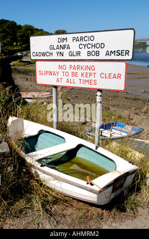 Old dingy rowing boat on slipway in the River Teifi estuary at St Dogmaels Pembrokeshire West Wales UK - Stock Photo