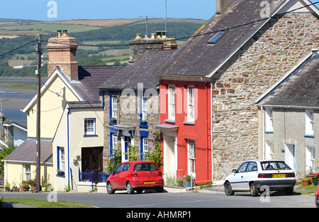 Terraced cottages with cars parked outside in coastal village St Dogmaels Pembrokeshire West Wales UK - Stock Photo