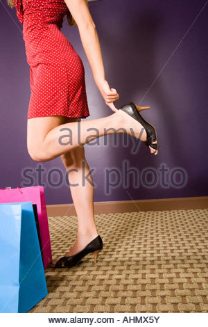 Woman putting on high heel shoe with a shoe horne Stock ...