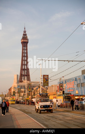 Beach Patrol Vehicle traveling along the Tram tracks along the promenade at Blackpool,with Tower in  background,lancashire,UK, - Stock Photo