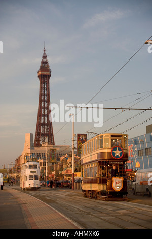 Blackpool Trams passing each other on the Promenade near the Tower, Lancashire,sunset,UK,GB - Stock Photo