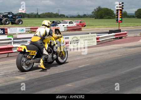 Yellow and black motorbike on startline at Melbourne Raceway North Yorkshire England - Stock Photo