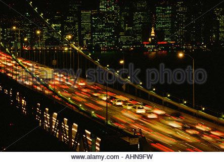 Time-lapse view of traffic on the Bay Bridge at night, San Francisco, California - Stock Photo