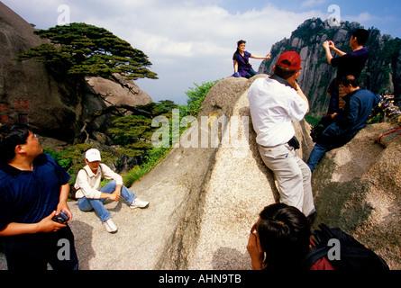 Huangshan tourists at Huangshan's (Yellow Mountain) Jade Screen Terrace - Stock Photo
