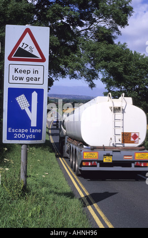 lorry passing emergency escape lane warning sign in case of brake failure on steep hill at staxton scarborough yorkshire - Stock Photo