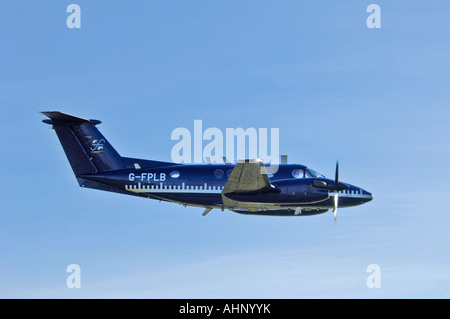 Flight Precision Ltd Beech Super King Air B200 G-FPLB Working on airfield runway calibration - Stock Photo