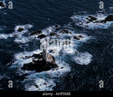 Longships Lighthouse off Land's End Cornwall UK aerial view - Stock Photo
