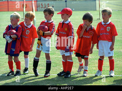 Children dressed in Manchester United Football shirts - Stock Photo