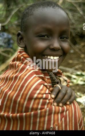 Portrait of a young Maasai boy near the Masai Mara National Reserve Kenya East Africa - Stock Photo