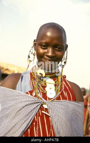 Vertical format close up portrait of a young Maasai woman near the Masai Mara National Reserve Kenya East Africa - Stock Photo