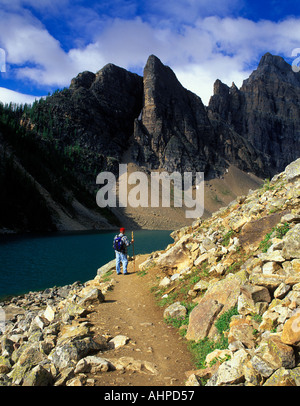 Hiker on path around Agnes Lake Banff National Park Canada - Stock Photo