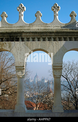 Vertical view of the Parliament Buildings on the horizon viewed through an arch at the Fishermen's Bastion on a - Stock Photo