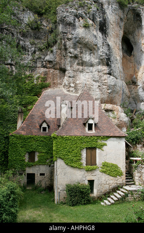 House under a cliff, Vers, France - Stock Photo