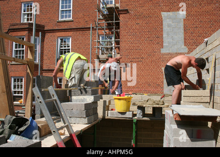 Brick layers at work in the UK - Stock Photo
