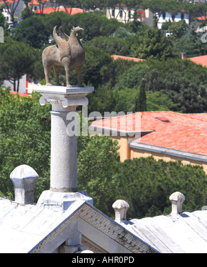 A stone hippogriff, half horse half gryphon stands over the Campo Santo in Pisa. - Stock Photo