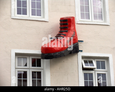 8f8bb8c72c5 Red Doc Martin boot hangs above the Boot Store Camden High Street Camden  Town London England